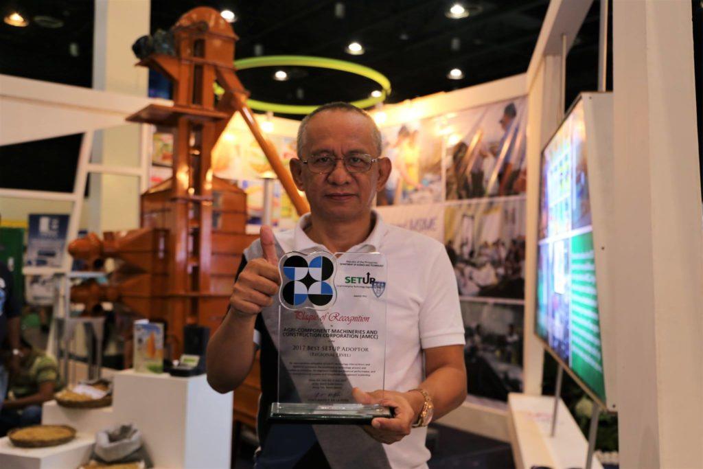 Engr. Rolando Rupac shows the plaque award of AMCC for Best SETUP adoptor for Region 2.